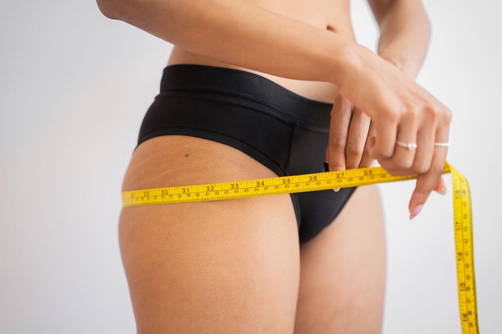 tummy tuck vs lipo